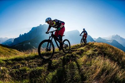 Andreas Tonellie and Tobias Woggon riding in Passo Sella, Dolomites, Italy.